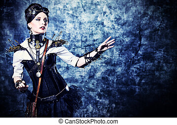 touch science - Portrait of a beautiful steampunk woman over...
