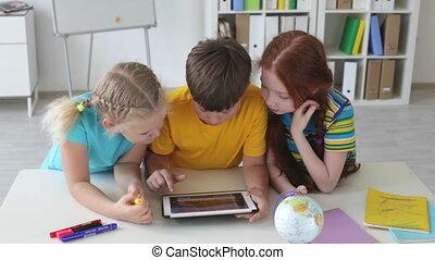 Modern schoolchildren - Schoolchildren playing video games...