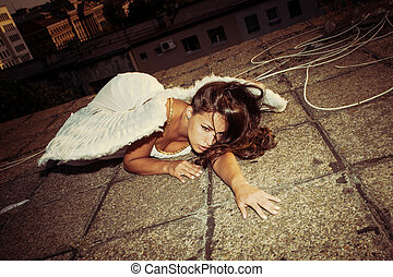 fallen angel - beautiful angel woman with white wings lie on...