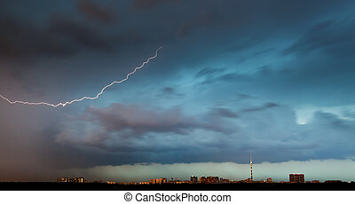 lightning bolt in storm clouds over city