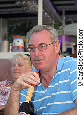 smoking a hookah waterpipe - Portrait of a man smoking a...