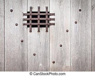 aged wooden door with ironwork