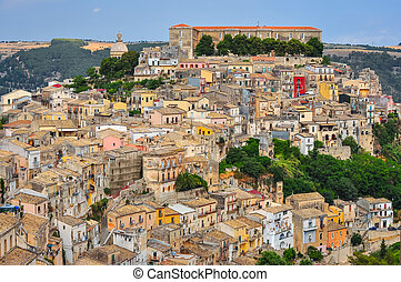 Colorful houses in old medieval village Ragusa in Sicily,...