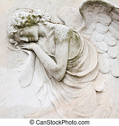sleeping angel - antique decoration on tombstone, monumental...