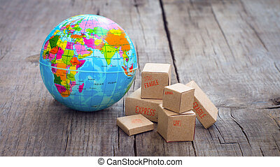 World Import and Export - Miniature globe and boxes on...