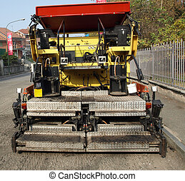 Road works with asphalt machine