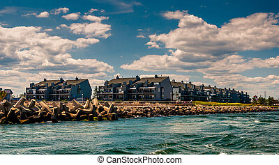 Waterfront condos and a jetty in Point Pleasant Beach, New...