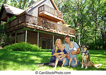 Happy Family at Cabin in the Woods
