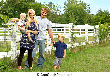 Happy Family Outside by Horse Pasture - a happy, attractive...