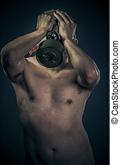 Industrial concept, nude man with gas mask