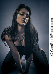 Dark fetish, beautiful brunette young with silver chains