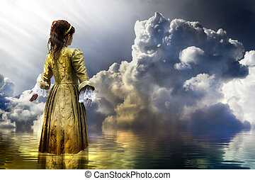 Fairy concept. woman in clam water over dark clouds
