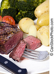 Top Sirloin Steak - A grilled top sirloin steak medium with...