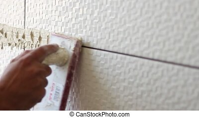 Grout on tiles - Building tiles wall