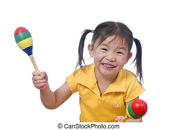 Playing Maracas - A young girl playing with maracas....