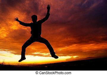 Stunned in mid-air - silhouette of a guy hanging in mid air