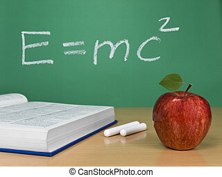 E=mc2 - Einstein´s formula on a chalkboard with an apple,...