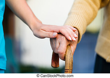 Helping the Elderly - Doctor holding a senior patiens s hand...