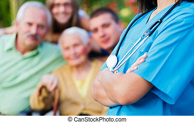 Caregiver and Family - Confident doctor welcoming patients,...