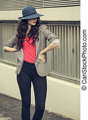 Attractive glamorous brunette wearing stylish clothes posing...