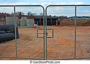 Locked gates on construction site - Locked entrance to...