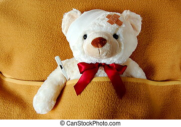 sick teddy bear - ill teddy bear in bed waiting for medicine