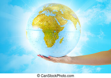 Earth globus in hand - Abstract background for presentation,...