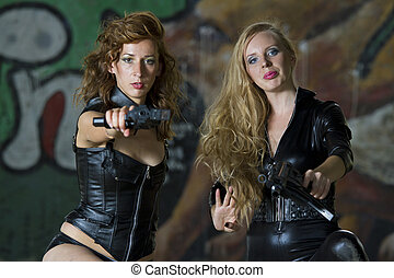 Two leather clad gun girls