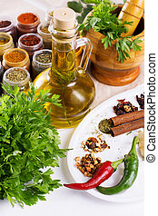 Mix of fresh herbs, spices and oil on the table