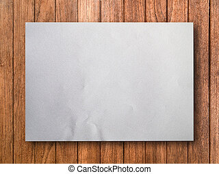 Blank White Paper on Wood
