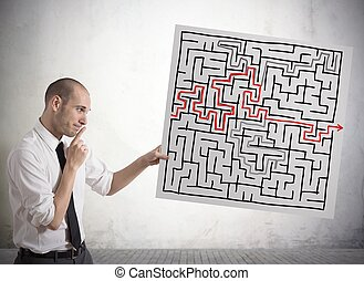 Solution for the maze - Businessman finding solution for the...