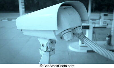 DOLLY: CCTV Camera - CCTV camera on corner of retail gas...