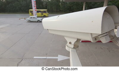 DOLLY: Security Camera - Security camera of gas station...