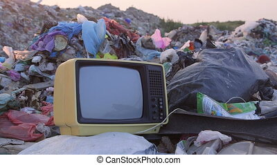DOLLY: Old TV in Landfill - Old TV set in landfill, tracking...