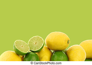 freshly cut lime fruit and some lemons on a green background...