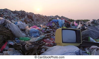 DOLLY: Garbage Dump At Sunset - Garbage dump at sunset, old...