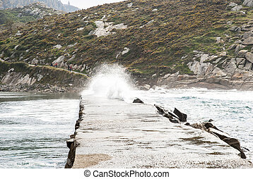 Waves over path at Cies island natural park, Galicia - Waves...