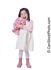 Young Girl with stuffed animal - A young asian girl with her...