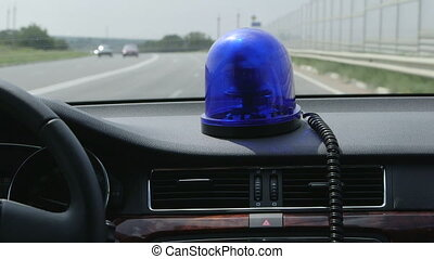car with blue flashing light - Driving car with blue...
