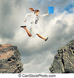 Young businesswoman jumping - Image of young businesswoman...
