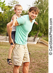 Family Father Man and Son Boy Child playing Outdoor Happiness emotion with summer nature on background