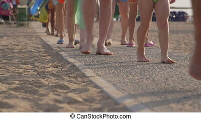going to the summer beach - Crowd of holidaymakers going to...