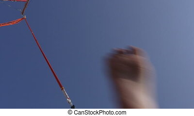 bungee trampoline - Little girl bouncing up and down on a...