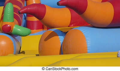 inflatable water slide - Kids sliding down an inflatable...