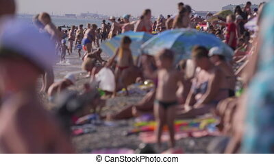 Crowded Summer Beach - Crowded summer beach, focus on the...