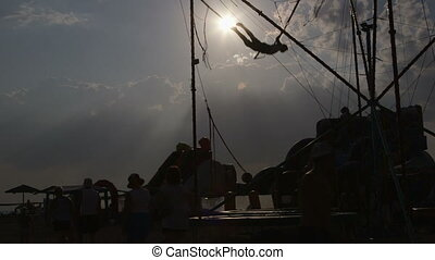 beach fun on bungee trampoline - Summer beach fun on bungee...