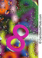 Number eight on abstract colorful drops background
