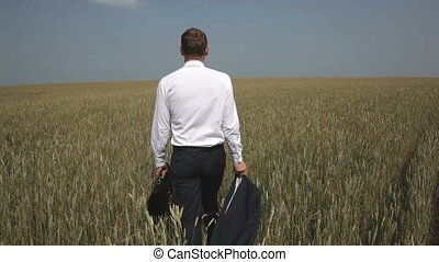 To the horizon - The rear-view of a young businessman...