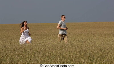 Enjoying freedom - Young couple enjoying freedom running...