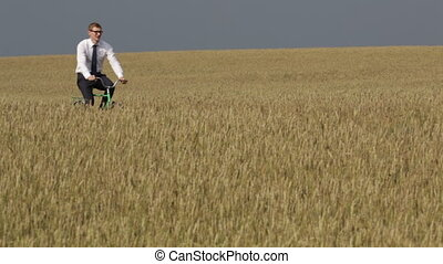 Speed up - Businessman speeding up while cycling across the...